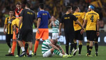 Celtic's Leigh Griffiths sits on the pitch after his team were dumped out of the Champions League by AEK Athens