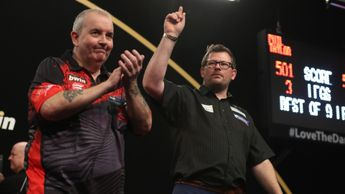 Phil Taylor was defeated by James Wade as both progressed (Picture: Lawrence Lustig/PDC)