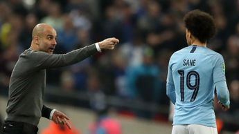 Manchester City boss Pep Guardiola with Leroy Sane