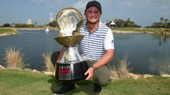 Eddie Pepperell with the Qatar Masters trophy