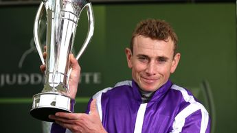 Ryan Moore with the Juddmonte International trophy