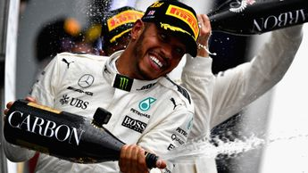 Lewis Hamilton celebrates his Silverstone success