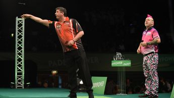 Mensur Suljovic in action against Peter Wright (Picture: PDC/Chris Deam)
