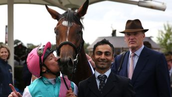 There's a kiss for Enable from Frankie Dettori as John Gosden looks on