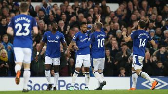 Theo Walcott celebrates scoring the only goal of the match