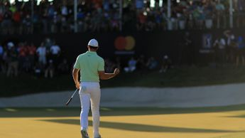 Rory McIlroy holes a final birdie putt to seal victory