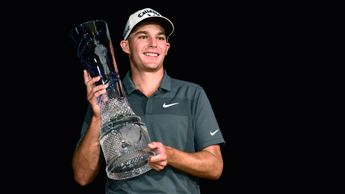 Aaron Wise with the Byron Nelson trophy