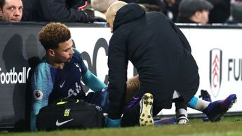 Dele Alli receives treatment on the sidelines at Fulham
