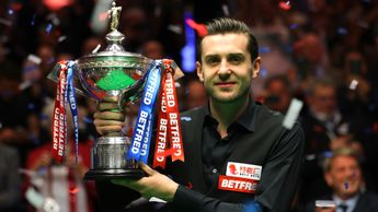 Mark Selby lifts the trophy