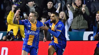 Jason Cummings celebrates scoring for Shrewsbury against Liverpool in the FA Cup