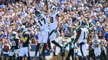 LA Rams players celebrate against the LA Chargers