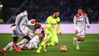 Lionel Messi finds his way through the Lyon defence