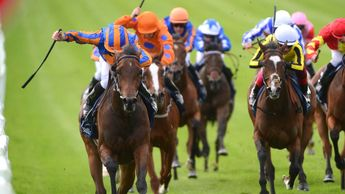 Hermosa and Ryan Moore (left) win the Group 1 Tattersalls Irish 1,000 Guineas