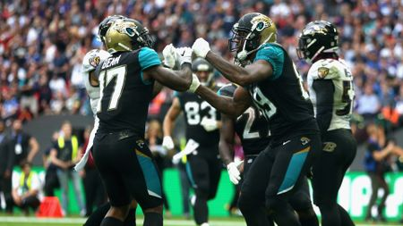 Marcedes Lewis of the Jacksonville Jaguars celebrates with Arrelious Benn