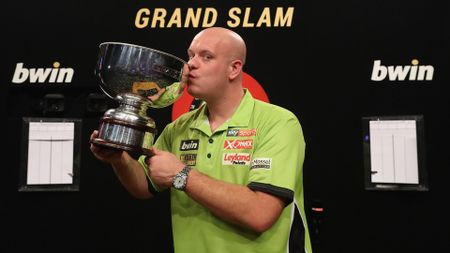 Michael van Gerwen celebrates his Grand Slam of Darts victory (Picture: Lawrence Lustig/PDC)