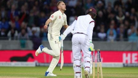 Stuart Broad celebrates for England
