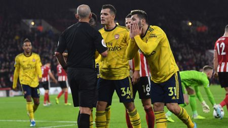 Granit Xhaka: Arsenal midfielder (centre, number 34) addresses referee Mike Dean during the defeat at Sheff United