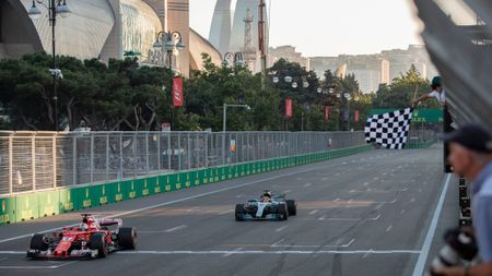Vettel and hamilton cross the line in Baku