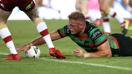 Tom Burgess stretches out to score