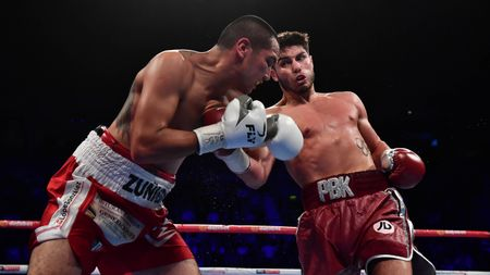 Josh Kelly (right) lands a right hand