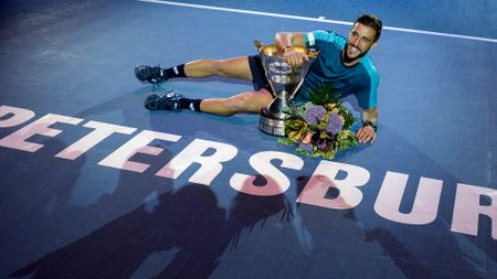 Damir Dzumhur celebrates with the trophy after winning the St. Petersburg Open