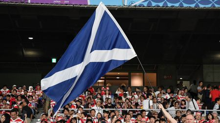 A Scotland flag is waved during their match with Japan