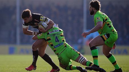 Ollie Devoto of Exeter is tackled by Northampton's Michael Paterson
