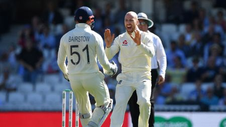 Jack Leach (right) celebrates