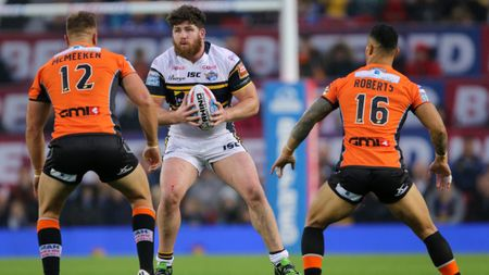 Mitch Garbutt: The prop (pictured centre, in action for Leeds) has signed a three-year deal with Hull KR