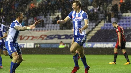 Dan Burn celebrates his goal for Wigan against Bournemouth