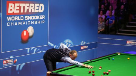 Mark Williams in action against Martin Gould