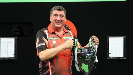 Mensur Suljovic with the Champions League of Darts trophy (Lawrence Lustig, PDC)