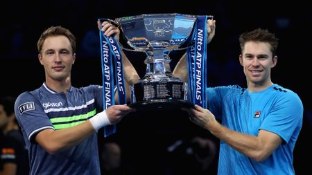 Henri Kontinen (l) and John Peers lift the trophy for the second year in a row