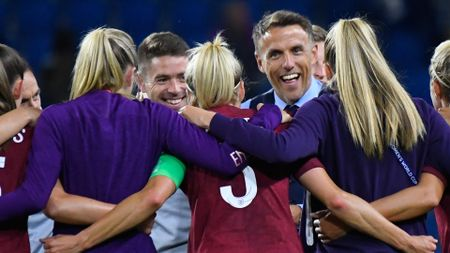 England's players and manager Phil Neville celebrate their win over Argentina