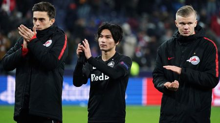 Takumi Minamino (centre): Pictured after RB Salzburg's defeat to Liverpool in the Champions League