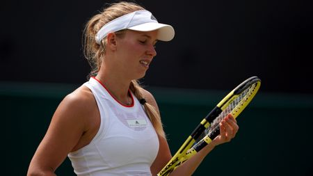 A frustrated Caroline Wozniacki crashes out