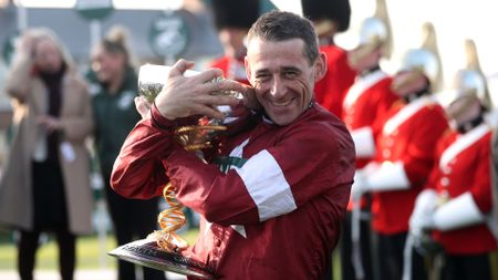 Davy Russell celebrates winning the 2018 Randox Health Grand National