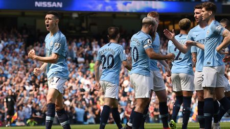 Phil Foden celebrates scoring the opening goal for Manchester City against Tottenham in the Premier League