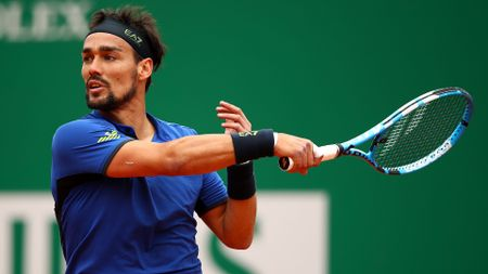 Fabio Fognini of Italy plays a forehand against Dusan Lajovic of Serbia