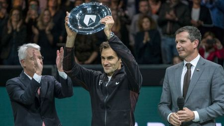 Roger Federer with the ABN AMRO World Tennis Tournament trophy