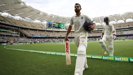 Virat Kohli walks off the pitch