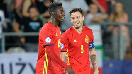 Hat-trick hero Saul Niguez (right)