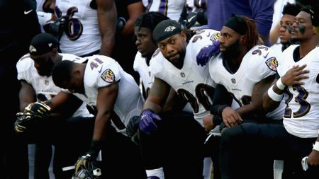 Baltimore Ravens players during the American anthem