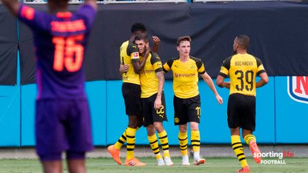 Christian Pulisic celebrates scoring against Liverpool with his Borussia Dortmund teammates