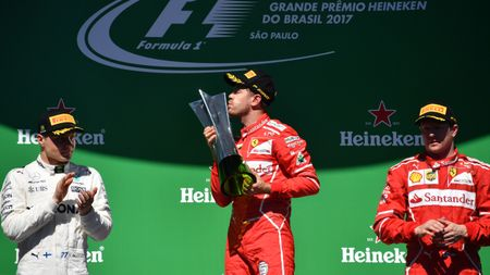 Sebastian Vettel celebrates victory at Interlagos