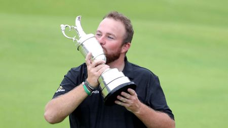 Shane Lowry kisses the Claret Jug as he celebrates winning The Open at Royal Portrush