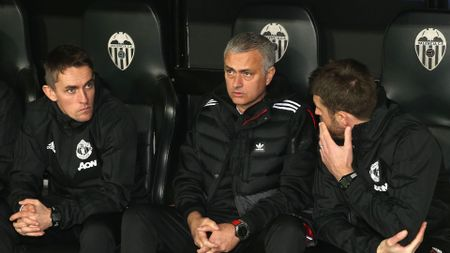 Jose Mourinho on the bench with his coaching staff