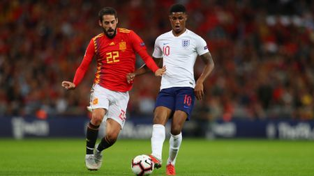Marcus Rashford and Isco battle for the ball
