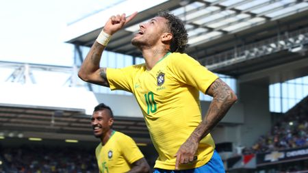 Neymar celebrates after scoring for Brazil at Anfield