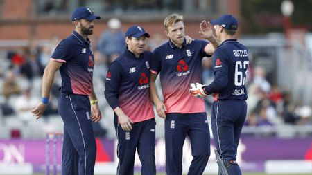 David Willey is congratulated after taking a wicket